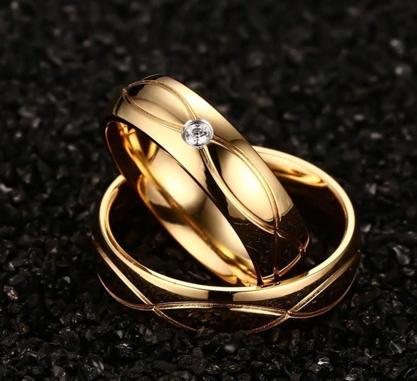 Aliança de aço banhada a ouro uma pedra 6mm
